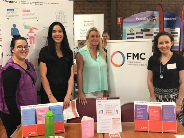 four attendees of the Be Seen event standing at the Mediation and Counselling booth