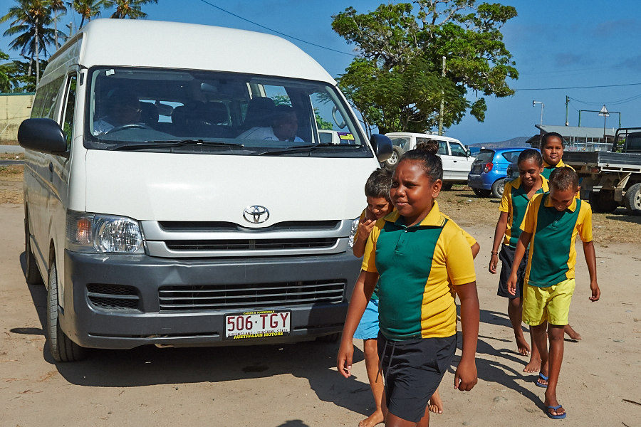 Indigenous children on Palm Island benefiting from our community bus that takes them to and from school - this bus is an example of our Youth and Family services